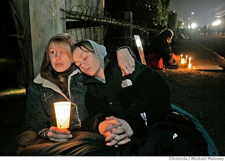 "WILLIAMS_275_MJM.jpg  Amanda Barovro of Argentina and Sylvia Calierno of Berkeley comfort each other after Williams was executed.  The vigil outside the gates to San Quentin Prison where Stanley ""Tookie"" Williams was executed shortly after midnight, Tuesday morning December 13, 2005. Pro and anti death penalty advocates were on hand to voice and demonstrate their views.  Williams, once the leader of the Crypts gang was convicted and sentenced to death for 4 murders. The governor refused clemency for Williams Monday.  Event in San Quentin, CA  Photo by Michael Maloney / The Chronicle MANDATORY CREDIT FOR PHOTOG AND SF CHRONICLE/ -MAGS OUT Photo: Michael Maloney"