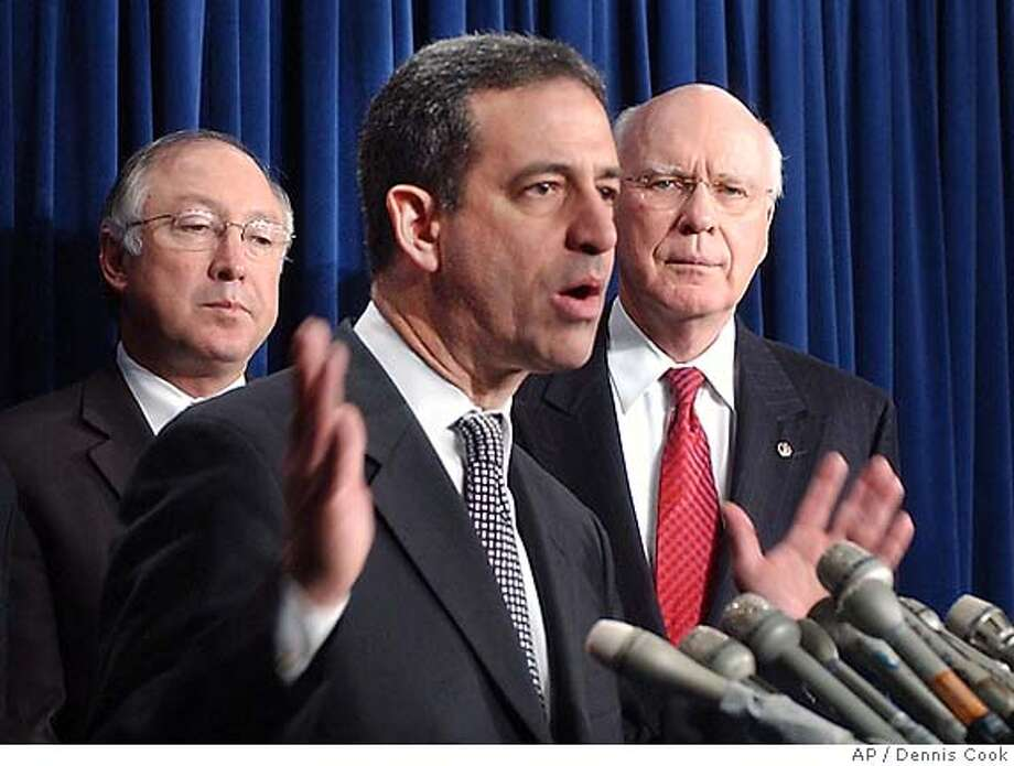 The Senate Friday, Dec. 16, 2005, rejected attempts to reauthorize several provisions of the USA , dealing a huge defeat to the Bush administration and Republican leaders. Senator Russ Feingold, D-Wis., center, threatened to fillibuster the measure. Flanking Sen. Feingold during a news conference after the vote are Sen. Ken Salazar, D-Colo., left, and Sen. Patrick Leahy, D-Vt. (AP Photo/Dennis Cook) Photo: DENNIS COOK