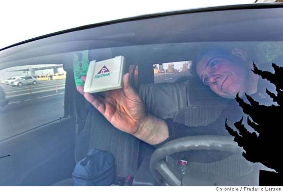 FASTRAK_092_fl.jpg Michael McLaughlin after signing up for FasTrak puts his transponder in his front window of his car. Caltrans will open two more FasTrak lanes on Monday at the Bay Bridge toll plaza, and the agency hopes more people will subscribe to the electronic toll service so that the added lanes are well-used come next week.  12/17/05 Oakland CA Frederic Larson San Francisco Chronicle Photo: Frederic Larson