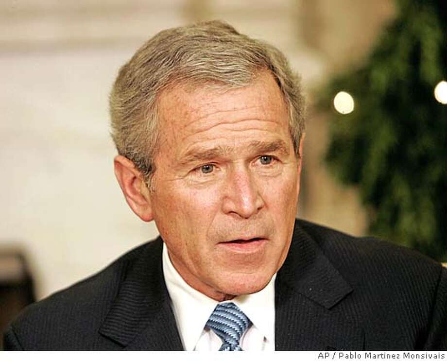 President Bush speaks to reporters during his meeting with the Iraqi Ambassador to the United Nations, Samir Shakir al-Sumaydi in the Oval Office of the White House, Friday, Dec. 16, 2005 in Washington. (AP Photo/Pablo Martinez Monsivais) Photo: PABLO MARTINEZ MONSIVAIS