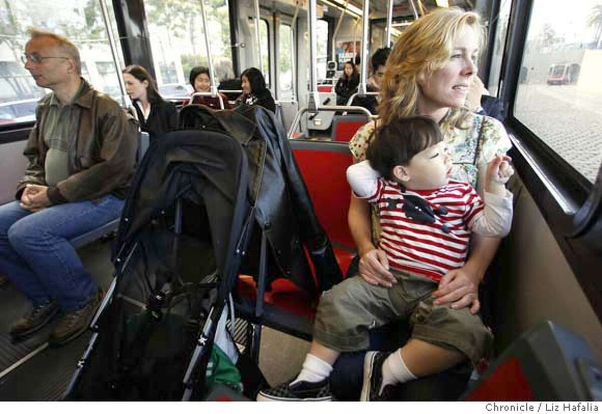 MUNI03_LH_082.JPG Lynn Johnson from San Francisco picks up her son Damian Chock, 2 years old, at daycare in the Civic Center after work and brings him home on Muni's T rail. Photographed by Liz Hafalia/The Chronicle/San Francisco/6/1/07 **Lynn Johnson, Damian Chock cq MANDATORY CREDIT FOR PHOTOGRAPHER AND SAN FRANCISCO CHRONICLE/NO SALES-MAGS OUT