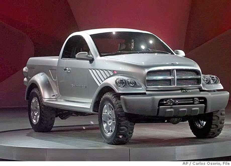DaimlerChrysler AG unveiled the Dodge Power Wagon, an oversized pickup packed with a 7.2-liter, turbocharged diesel engine designed to run on a synthetic diesel-type fuel. The vehicle made its debut at the North American International Auto Show in Detroit, Sunday, Jan. 3, 1999. (AP Photo/Carlos Osorio) Ran on: 12-17-2005  Dodge unveiled a new Power Wagon in 1999 (shown above) resurrected it commercially last year. Photo: CARLOS OSORIO