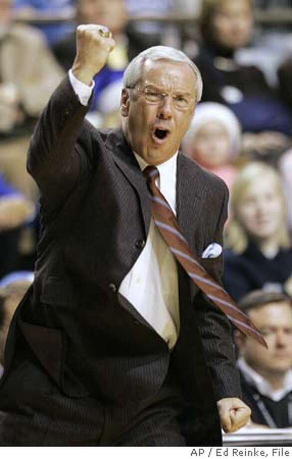 North Carolina coach Roy Williams cheers his team's performance during the second half of their 83-79 upset win over Kentucky Saturday, Dec. 3, 2005, in Lexington, Ky. (AP Photo\Ed Reinke) Ran on: 12-04-2005  North Carolina's Reyshawn Terry (left) had his way above the rim with 25 points and made coach Roy Williams' day (above). The unranked Tar Heels ended No. 10 Kentucky's 11-game winning streak at Rupp Arena. Ran on: 12-04-2005  North Carolina's Reyshawn Terry (left) had his way above the rim with 25 points and made coach Roy Williams' day (above). The unranked Tar Heels ended No. 10 Kentucky's 11-game winning streak at Rupp Arena. Ran on: 12-04-2005  North Carolina's Reyshawn Terry (left) had his way above the rim with 25 points and made coach Roy Williams' day (above). The unranked Tar Heels ended No. 10 Kentucky's 11-game winning streak at Rupp Arena. Photo: ED REINKE