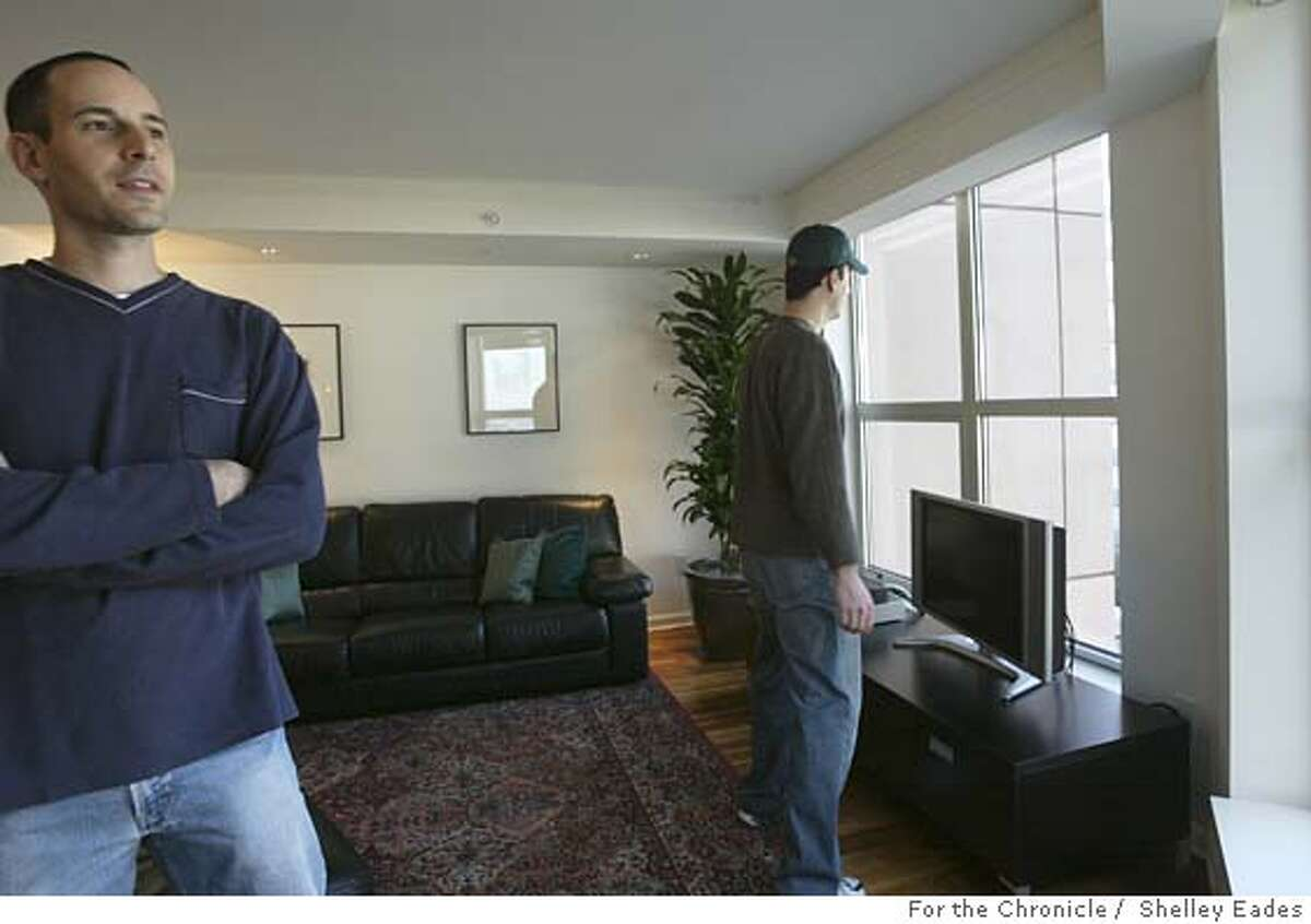 Nicholas Delis, left, and cousin Nick Vandarakis, right, tour this 3-bedroom condo on Beale Street listed for $1.15 million in South Beach. Vandarakis currently rents a condo in the same building. *Note: Subjects contact info for reporter: Nick Vandarakis (415)875.4542 Shelley Eades The Chronicle /mandatory credit photog