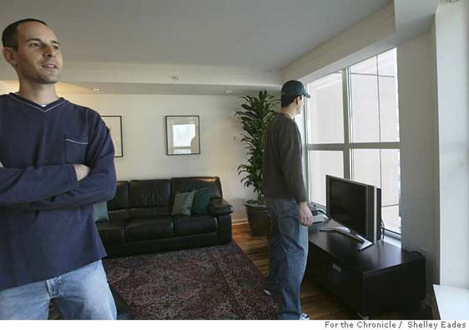 Nicholas Delis, left, and cousin Nick Vandarakis, right, tour this 3-bedroom condo on Beale Street listed for $1.15 million in South Beach. Vandarakis currently rents a condo in the same building.  *Note: Subjects contact info for reporter: Nick Vandarakis (415)875.4542  Shelley Eades The Chronicle /mandatory credit photog Photo: Shelley Eades