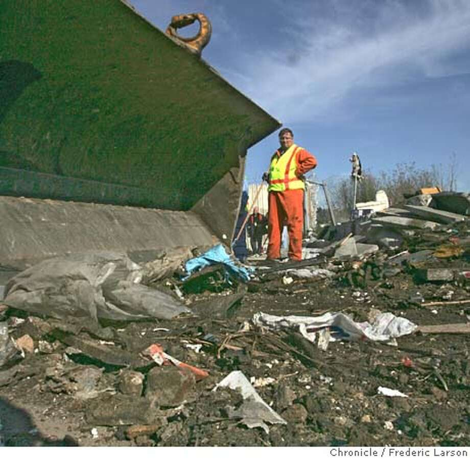 GARBAGE_085_fl.jpg Jimmy McGarty from DPW helps clean up an illegal dumping sites in the Bayview at dead end of Van Dyke Avenue, past Ingalls Street.  12/16/05 San Francisco CA Frederic Larson San Francisco Chronicle Photo: Frederic Larson