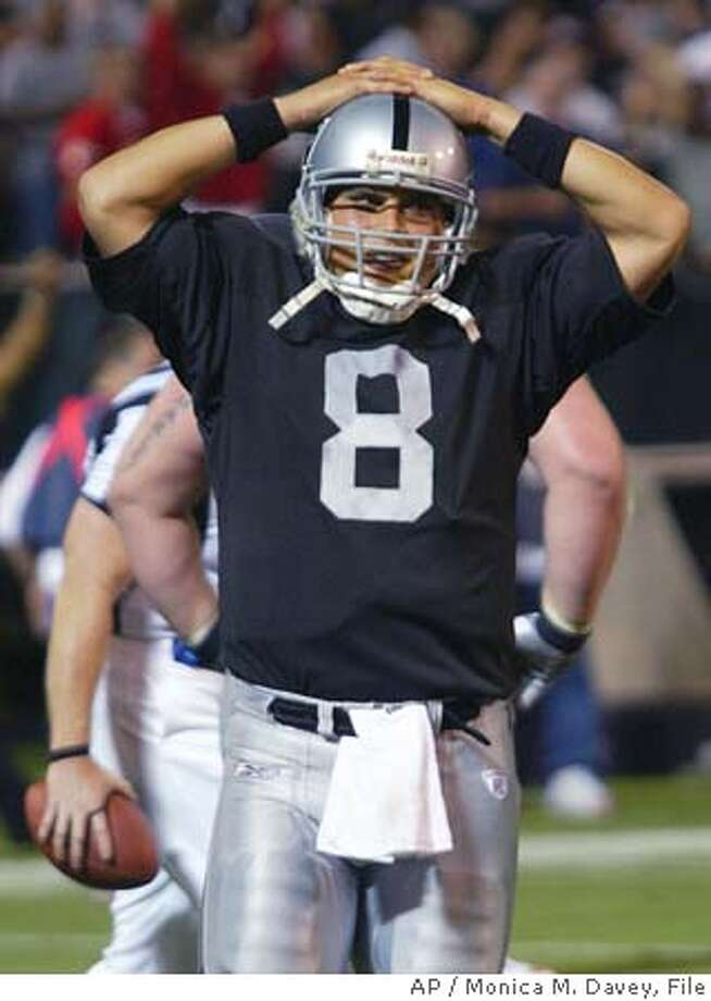 Oakland Raiders backup quarterback Marques Tuiasosopo reacts as the time ran out on the Raiders at the end of the game against the Kansas City Chiefs at Network Associates Coliseum in Oakland, California, October 20, 2003. After starting quarterback Rich Gannon was injured, Tuiasospo led the Raiders on a drive that almost tied the game in the final minute.The Chiefs won 17-10. REUTERS/Monica M. Davey Whether it's because of injuries or the effects of the Super Bowl beating, Rich Gannon has not thrown as accurately or been as mobile out of the pocket as in the past. Rich Gannon, left, has struggled mightily, but Marques Tuiasosopo's comeback was against a defense playing soft to protect a lead. Ran on: 12-16-2005  Marques Tuiasosopo has never started at the Coliseum in his five years with the Raiders. Photo: MONICA DAVEY