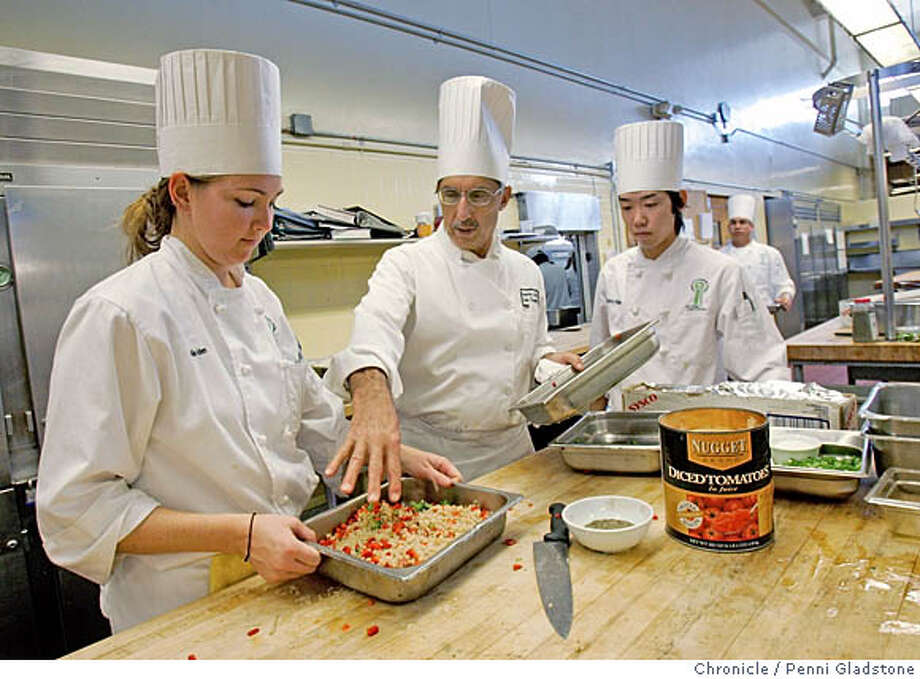 in middle is exec. Chef and instructor John Scopazzi talking with students,  at left Natalie Iben and at rt Shintaro Hiraide. They are preparing lunch.  Story about City College's culinary institute -  Finding a gourmet meal for well under $10 in food-obsessed San Francisco may seem like an absurd proposition � unless you�re willing to take a trip out to City College�s main campus The dining takes place at the Pierre Coste Dining Room, a full service restaurant featuring roving waiters in formal dress; the City Room, a cafeteria with made-to-order stations for entrees, sandwiches and desserts; Photo taken by Penni Gladstone/The San Francisco Chronicle  Photo taken on 11/22/05, in San Francisco, CA. Photo: Penni Gladstone