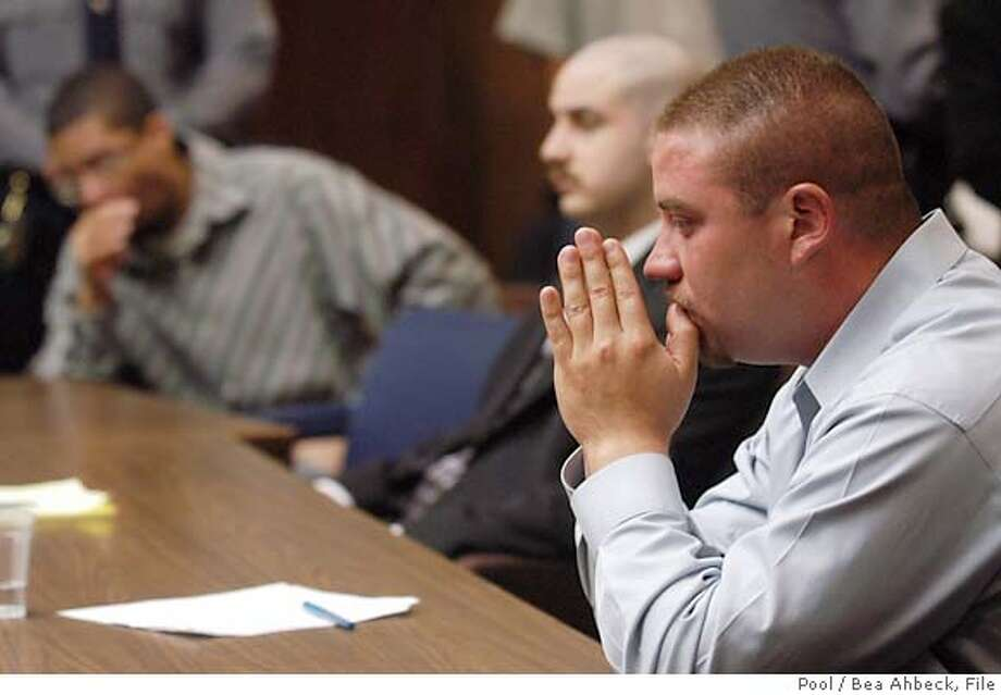 Jason Cazares, right, Jose Merel, left, and Michael Magidson, center, listen to verdicts in a Hayward, Calif., courtroom, Monday, Sept. 12, 2005 for the killing of Gwen Araujo. Merel and Magidson were found guilty of killing the transgender teen. They were both cleared of hate crime charges. The jury deadlocked in the case of Cazares, marking the second time a mistrial was declared. (AP Photo/Bea Ahbeck/Fremont Argus, pool) Photo: BEA AHBECK