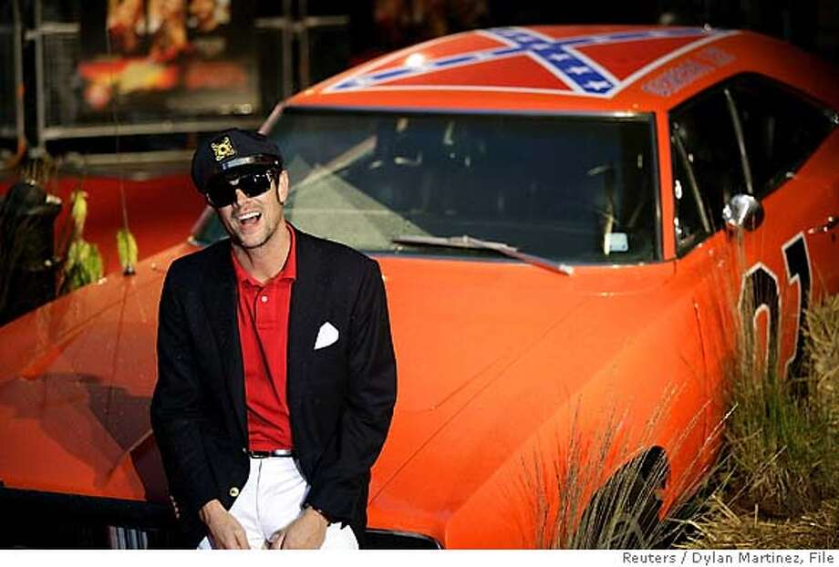 "Actor Johnny Knoxville of the U.S. sits on the ""General Lee"" car at the film premiere of ""The Dukes of Hazzard"" at the Vue Cinema, Leicester Square, London August 22, 2005. The film opens in Britain on August 26, 2005. REUTERS/Dylan Martinez Ran on: 09-04-2005  &quo;The Dukes of Hazzard&quo;: fun for the less than intelligent? Ran on: 12-16-2005  Star of &quo;The Dukes of Hazzard&quo; movie Johnny Knoxville poses with the Dodge Charger his character drives in the film. Photo: DYLAN MARTINEZ"