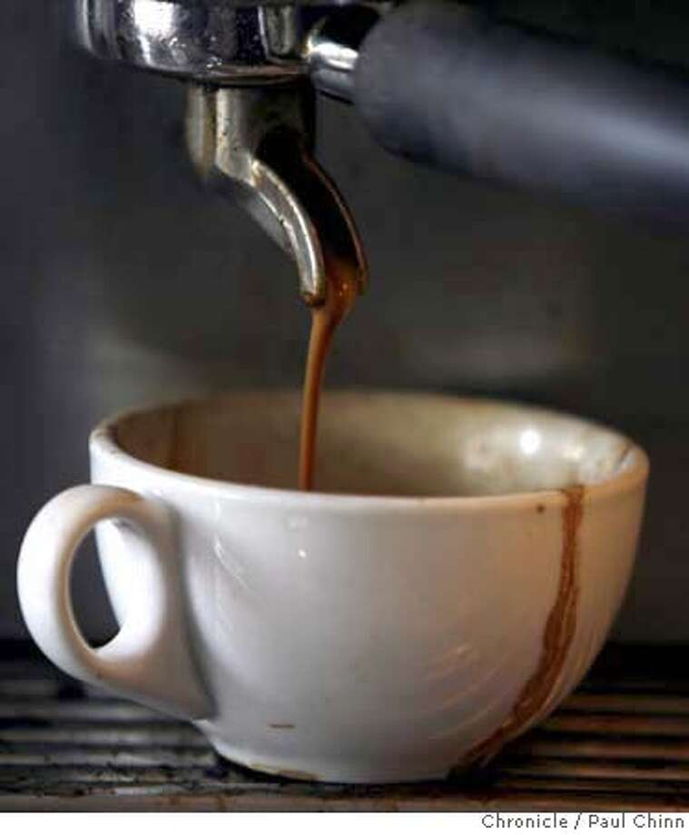 Espresso pours out of a coffee maker at the French Hotel Cafe in Berkeley, Calif. on Friday, June 8, 2007. A study reveals that, yes, it is healthy to regularly consume coffee.  PAUL CHINN/The Chronicle MANDATORY CREDIT FOR PHOTOGRAPHER AND S.F. CHRONICLE/NO SALES - MAGS OUT Photo: PAUL CHINN