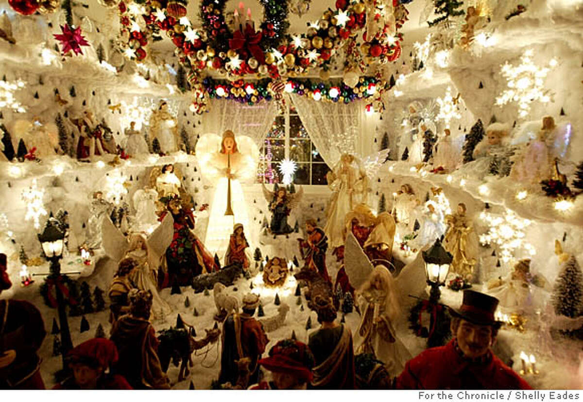 A bedroom is transformed into an angel room at the Rombieros' family home in Novato. From the first of December through Jan. 6 the Rombiero's hold an open house of their Novato home. Every night from 6-10 p.m., folks flock to take a gander and wander through the home, which is decorated wildly inside and out. Shelley Eades The Chronicle