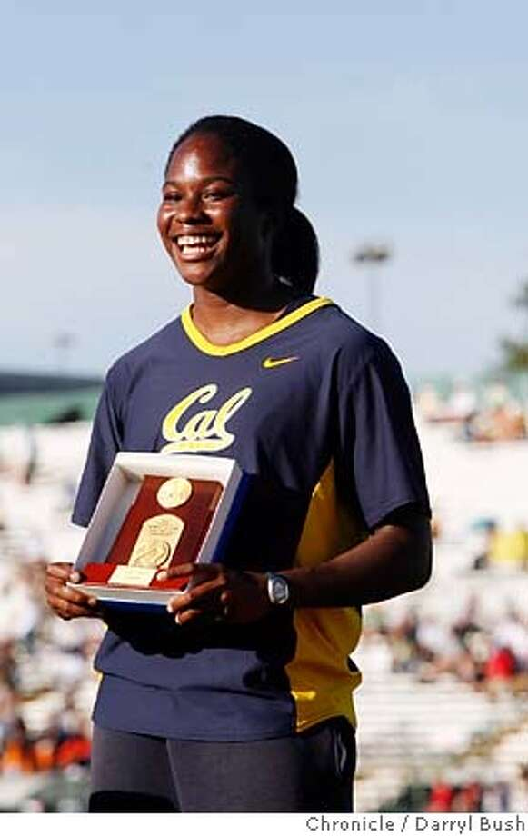 ncaatrack_0004_db.JPG  Kelechi Anyanwu of California, holds her trophy on the victory stand after winning Women Discus Throw, at the NCAA Division 1 2007 Outdoor Track & Filed Championship at Sacramento State University, Hornet Stadium in Sacramento, CA, on Friday, June, 8, 2007. photo taken: 6/8/07  Darryl Bush / The Chronicle ** roster (cq) MANDATORY CREDIT FOR PHOTOG AND SF CHRONICLE/NO SALES-MAGS OUT Photo: Darryl Bush