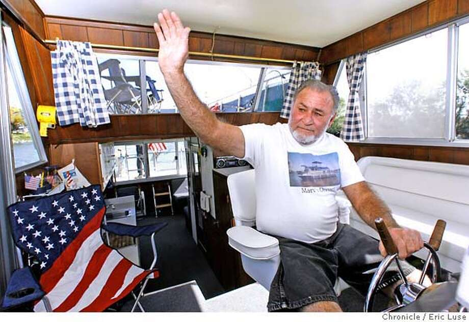 "Marv Mounce waves to a fellow boater while cruisin in his boat ""Marv's Dream"" along the Georgianna Slough. Houseboats as second homes in The Delta.  Photographer:  Eric Luse / The Chronicle names (cq) from source  Marv Mounce Photo: Eric Luse"