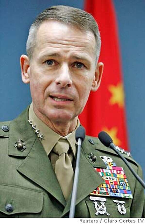 Chairman of the U.S. Joint Chiefs of Staff, Marine Gen. Peter Pace answers a question during a news conference in Beijing, in this March 23, 2007 file photo. Pace, the top U.S. military officer, will retire at the end of his term later this year and be replaced by Navy Adm. Mike Mullen, Defense Secretary Robert Gates said on June 8, 2007. REUTERS/Claro Cortes IV/Files (CHINA) 0 Photo: CLARO CORTES IV