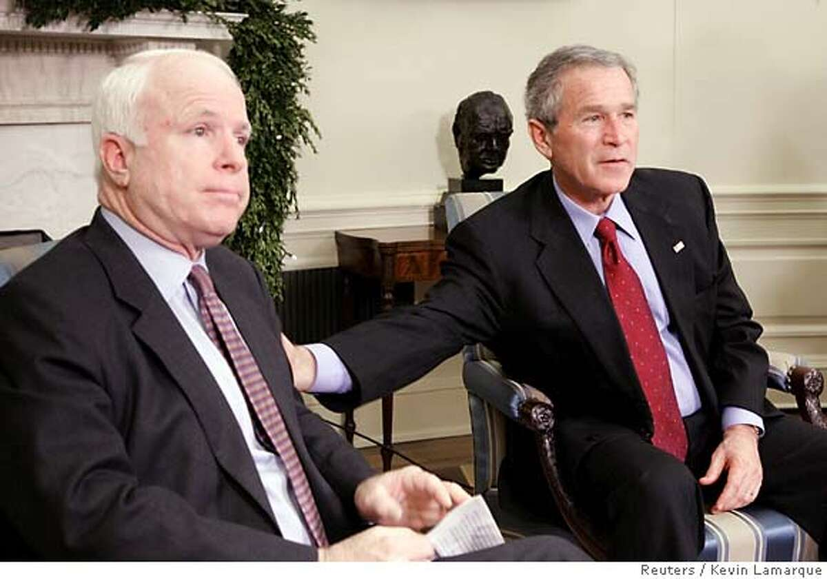 U.S. President George W. Bush reaches out to Sen. John McCain (R-AZ) during their meeting at White House's Oval Office in Washington December 15, 2005. The White House and McCain have reached agreement on McCain's amendment that would ban torture of detainees in U.S. custody, a spokeswoman for the Arizona Republican said on Thursday. Under bipartisan pressure, the White House accepted McCain's amendment, which would ban cruel, inhuman or degrading treatment of prisoners. The White House had sought protections from prosecution for interrogators accused of violating the rule, but McCain rejected that, saying it would undermine his amendment. REUTERS/Kevin Lamarque