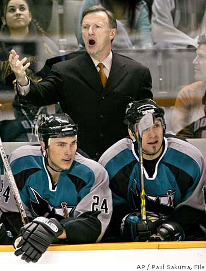 San Jose Sharks head coach Ron Wilson, upper, gestures as Sharks left wing Josh Langfeld, left, and left wing Scott Thornton, right, watch the game against the Atlanta Thrashers in the second period, Tuesday, Dec. 6, 2005 in San Jose, Calif. (AP Photo/Paul Sakuma) Photo: PAUL SAKUMA