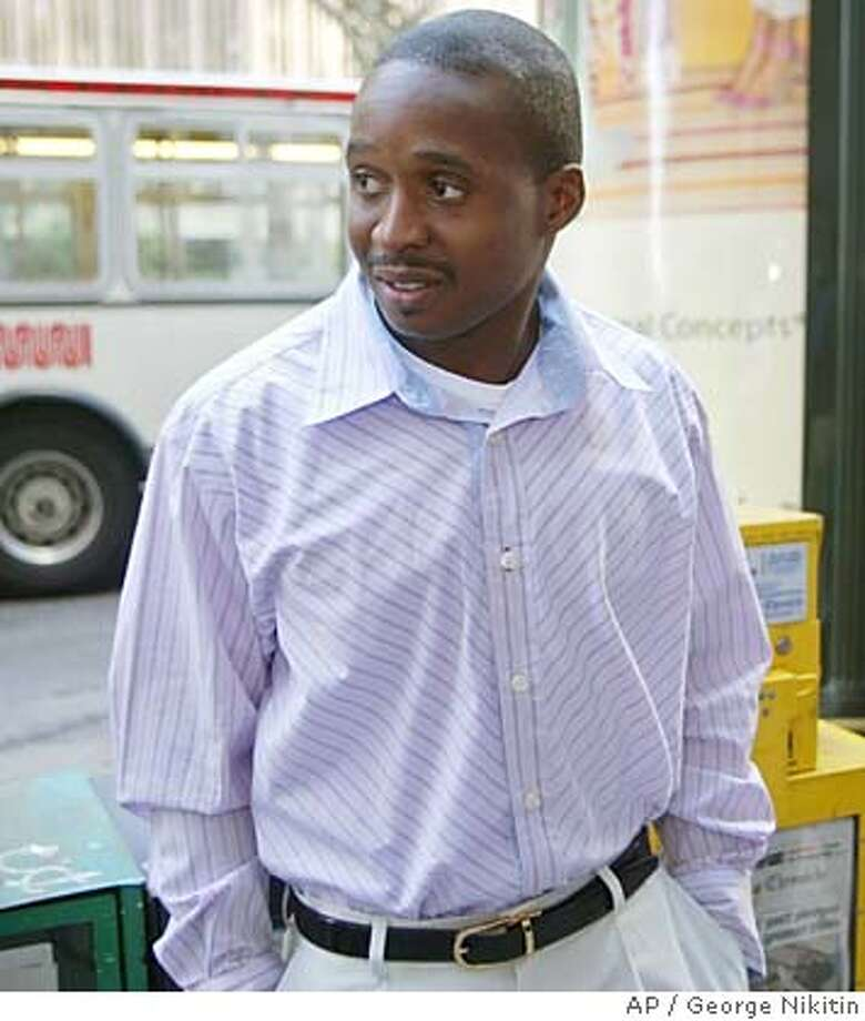 ** FILE ** Tim Montgomery arrives for his arbitration hearing before the Court of Arbitration for Sport, Monday, June 6, 2005, in San Francisco. Montgomery was suspended for two years for doping Tuesday Dec. 13, 2005, and the 100-meter world record he once held was wiped from the books. (AP Photo/George Nikitin) Photo: GEORGE NIKITIN