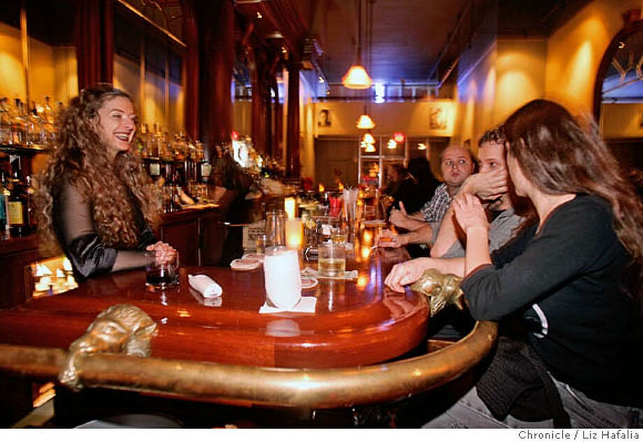 A nightlife story on a new club in Oakland, called Uptown. Bartender Logan Waters (left) at the bar where most of the fixtures are from the Old Spaghetti Factory formerly at Jack London Square. Photographed by Liz Hafalia on 12/1/05 in Oakland, California. SFC Photo: Liz Hafalia