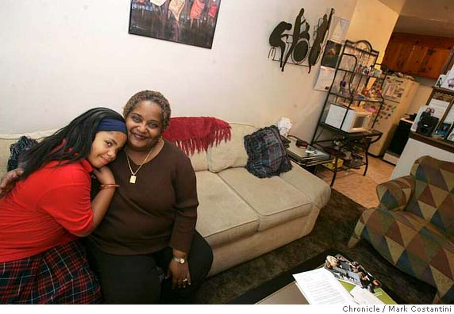 This is a season of sharing success story. Carmelita Goff lived in a homeless shelter for 6 months, until SOS helped her out. Pictured are Carmelita(right) and her daughter,O'Jainie(cq) Walker, 7, in thier home. Event on 12/09/05 in San Pablo  Photo: Mark Costantini /San Francisco Chronicle Photo: MARK COSTANTINI