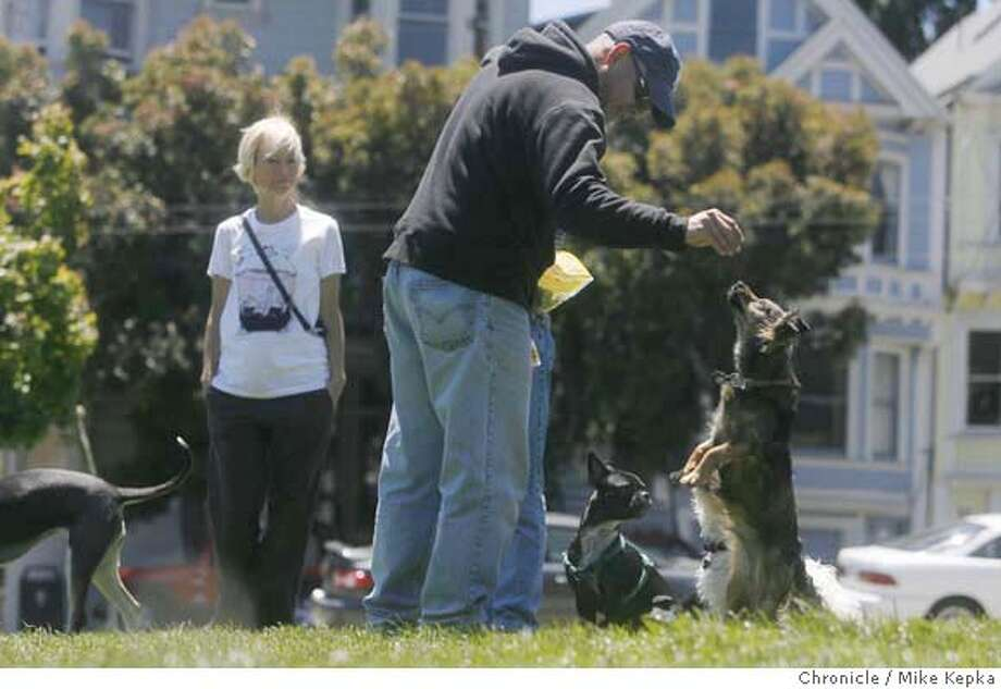 dogs000075.JPG Michelle White and Angelo Irizarry entertain their dogs In Duboce park where San Francisco dog owners speak their mind about a bill created in the state Assembly to require the spaying or neutering of pets. Mike Kepka / The Chronicle Michelle White Angelo Irizarry (cq) MANDATORY CREDIT FOR PHOTOG AND SF CHRONICLE/NO SALES-MAGS OUT Photo: Mike Kepka