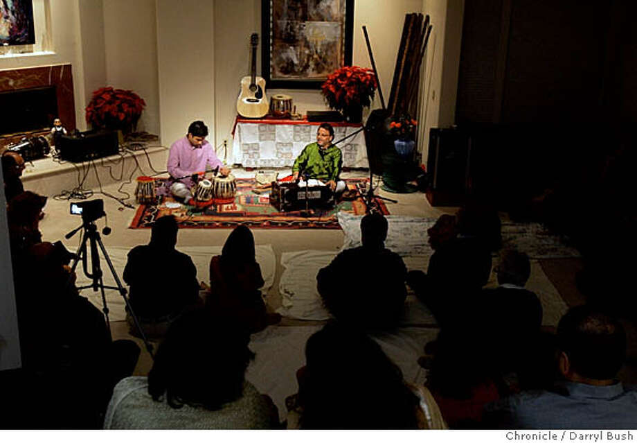 Musicians from India play music to large group during a traditional Indian concert at Janak Pathak's house.  Event on 11/25/05 in Fremont.  Darryl Bush / The Chronicle Photo: Darryl Bush