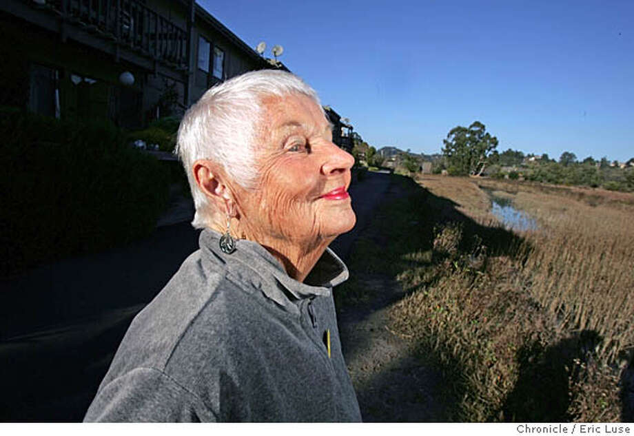 nbberry_065_el.JPG June Berry soaks up the view of the wet lands at the backside of her home at The Redwoods Retirement Community.  June Berry is 90. This resident of The Redwoods Retirement Community has won a Philanthropy of the Year Award for a special club she created at the Redwoods, to help the organization and some of its residents. She�s a real activist who was also one of the founders of Seniors for Peace.  .Event on nbberry_065_el.JPG in Mill Valley Eric Luse / The Chronicle Photo: Eric Luse