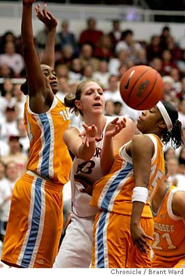 stanford017_ward.jpg  Stanford game high scorer Kristen Newline got off a pass between two Volunteer defenders.  Tennessee Lady Volunteers came to Maples Pavilion Sunday afternoon to take on the lady Stanford Cardinal...after a hard fought battle the final was 74-67, Tennessee wins.  12/4/05 Photo: Brant Ward