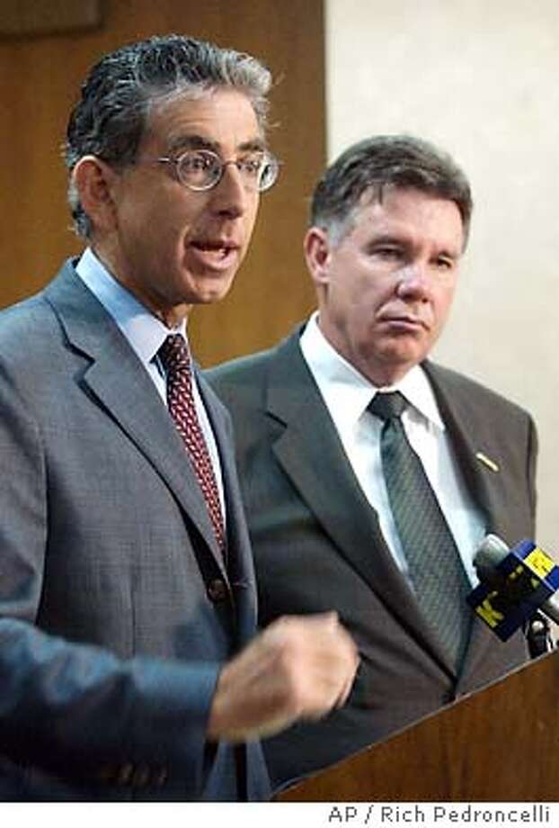 California State Treasurer Phil Angelides, left, gestures during a Sacramento news conference where he called for the resignation of New York Stock Exchange Chairman Richard Grasso to resign, Tuesday, Sept. 16, 2003. Angelides, who was joined by Sean Harrigan, president of the $130 billion California Public Employees' Retirement System, said that the recent disclosure of Grasso's nearly $140 million pay package endangers attempts to reform corporate governance.(AP Photo/Rich Pedroncelli) Photo: RICH PEDRONCELLI