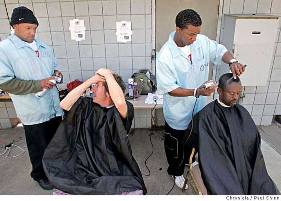 David Halenda (lower left) and Cornell Hurst (lower right) signed up for haircuts from barber college students Ronald Hill (top left) and O'Sean Head. Project Homeless Connect brought its unified collection of social services to the Bayview Hunters Point community in San Francisco, Calif. on Friday, June 8, 2007. It's the first time the project has delivered its resources directly to a neighborhood instead of its usual venue at the Bill Graham Civic Auditorium. There are an estimated 300-400 homeless people living in the Bayview Hunters Point neighborhood.  PAUL CHINN/The Chronicle  **David Halenda, Cornell Hurst, Ronald Hill, O'Sean Head Photo: PAUL CHINN