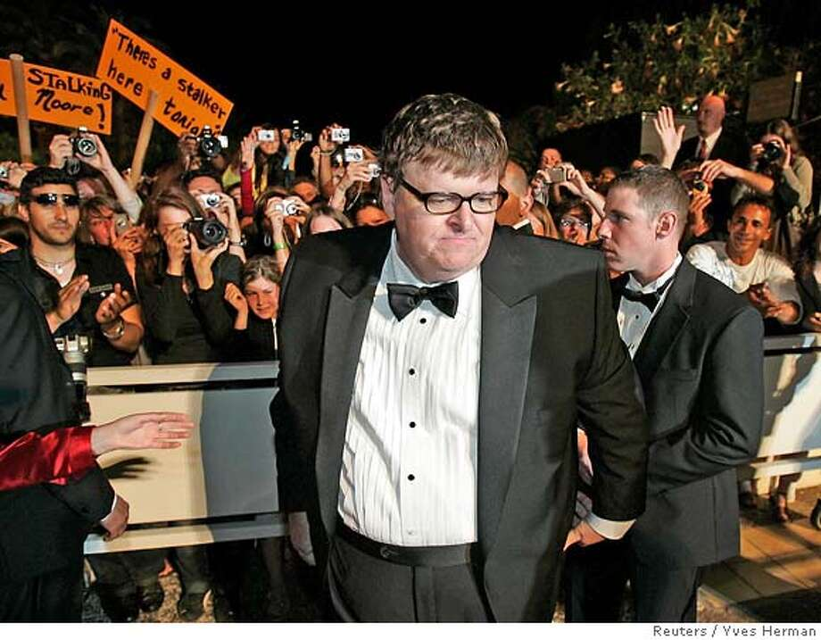 "U.S. director Michael Moore arrives for a gala screening of his film ""Sicko"" at the 60th Cannes Film Festival May 19, 2007. REUTERS/Yves Herman (FRANCE) Photo: YVES HERMAN"