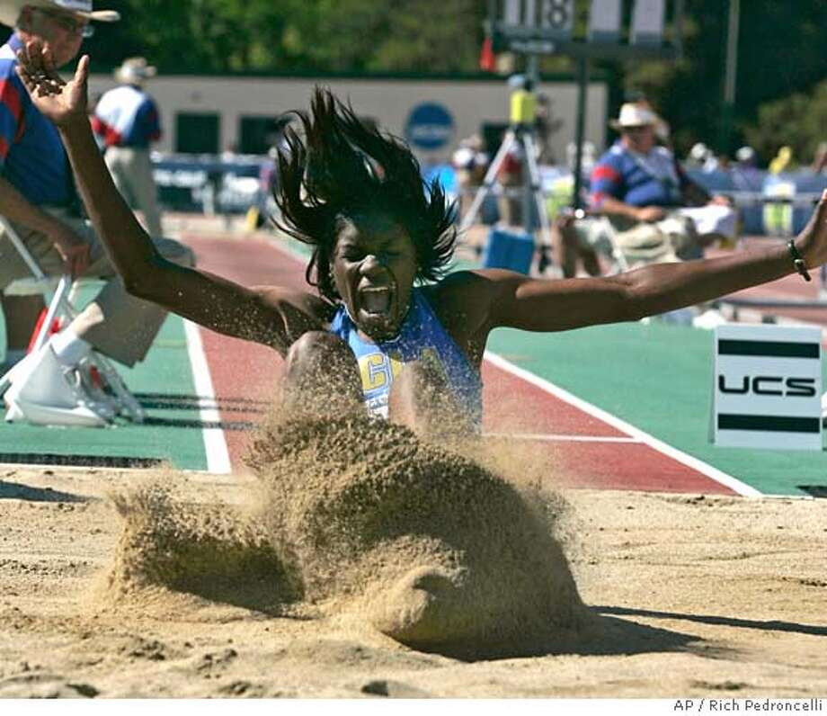 UCLA's Rhonda Watkins lands in the sand for a leap of 22 feet, 10 inches to win the women's long jump at the NCAA Division I track and field championships in Sacramento, Calif., Thursday, June 7, 2007.(AP Photo/Rich Pedroncelli) EFE OUT Photo: Rich Pedroncelli