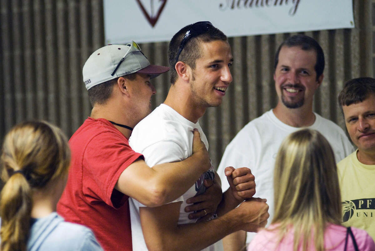 South Caldwell High School pitcher Madison Bumgarner is congratulated by coaches and classmates minutes after learning he was drafted by the San Francisco Giants in the first round of the 2007 Major League Baseball Draft.