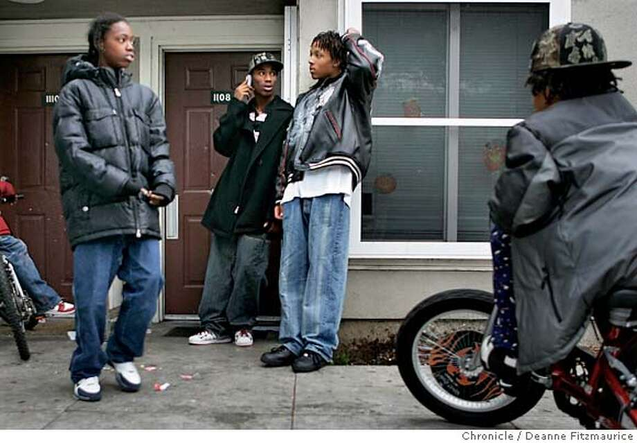 tookie_014_df.JPG  (l to r) Jason Howard, 13, Robert Gibson, 18, John Washington, 18, and Mark Jason, 14, (from back). Young people in the Fillmore District of San Francisco talk about their views on the Tookie Williams execution.  Event in San Francisco on 12/13/05.  Deanne Fitzmaurice / The Chronicle Photo: Deanne Fitzmaurice