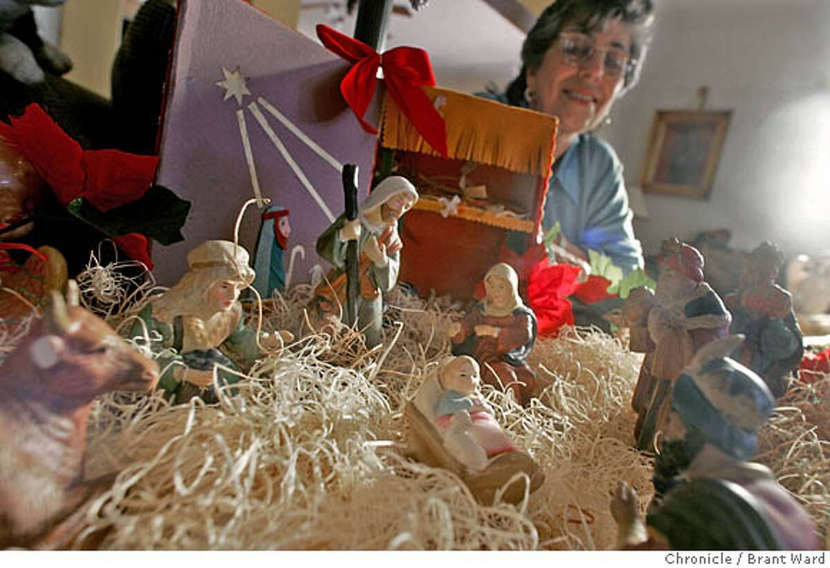 nativity030_ward.jpg Gloria Figueroa is pleased with her simple nativity scene she bought about a year ago...it also includes a manger she made out of an old cigar box several decades ago. Gloria Figueroa and her family have a simple nativity scene set up in their Oakland home and a number of antique nativity details around their house. 12/5/05
