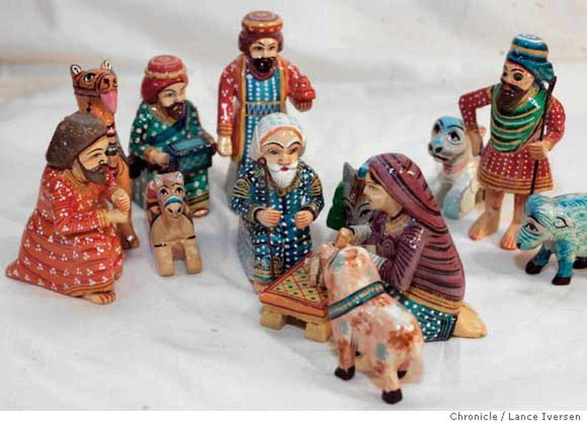 ADVENT26_0111.jpg_ Carlo and Mary Busby, owners of Sagrada, an eclectic religious store in Oakland. offer Advent calendars as well as a verity of Nativity scenes from around the world like this one from India. November 19, 2005. By Lance Iversen/San Francisco Chronicle