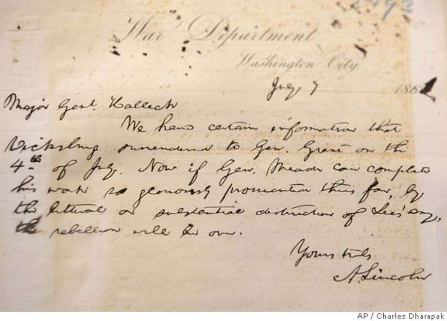 An original hand written note by President Abraham Lincoln, dated July 7, 1863, addressed to Maj. Gen. Henry Halleck during the Civil War, is displayed for the first time at the National Archives in Washington, Thursday, June 7, 2007. (AP Photo/Charles Dharapak) Photo: Charles Dharapak