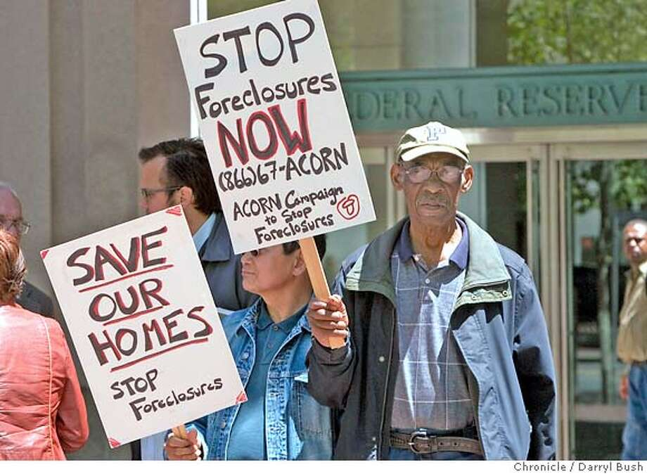 "acorn07_0001_db.JPG  Charles Young, right, and Dominador Osorio, left, both of San Francisco and members of ""ACORN"" hold signs, as a part of a small group of members and supporters of ""ACORN"" rally to stop predatory lending, outside San Francisco's Federal Reserve offices on Market Street in San Francisco, CA, on Wednesday, June, 6, 2007. photo taken: 6/6/07  Darryl Bush / The Chronicle ** Charles Young, Dominador Osorio (cq) MANDATORY CREDIT FOR PHOTOG AND SF CHRONICLE/NO SALES-MAGS OUT Photo: Darryl Bush"
