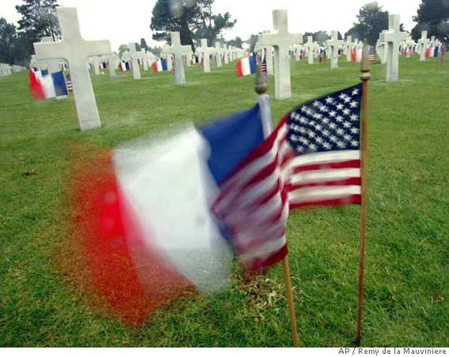 French and U.S. flags fly between graves at the American cemetery, in Colleville-sur-Mer, western France, Wednesday June 6, 2007, marking the 63rd anniversary of the D-Day landings in Normandy. (AP Photo/Remy de la Mauviniere) Photo: REMY DE LA MAUVINIERE