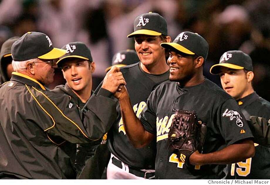 athletics_715_mac.jpg Oakland celebrates, A's closing pitcher 44- Santiago Casilla, (right center) gets Boston's Jason Varatek to fly out wiht one man on to end the game, Oakland wins 3-2. Oakland Athletics vs. Boston Red Sox at the McAfee Coliseum. Photographed in, Oakland, Ca, on 6/6/07. Photo by: Michael Macor/ The Chronicle Mandatory credit for Photographer and San Francisco Chronicle No sales/ Magazines Out Photo: Michael Macor