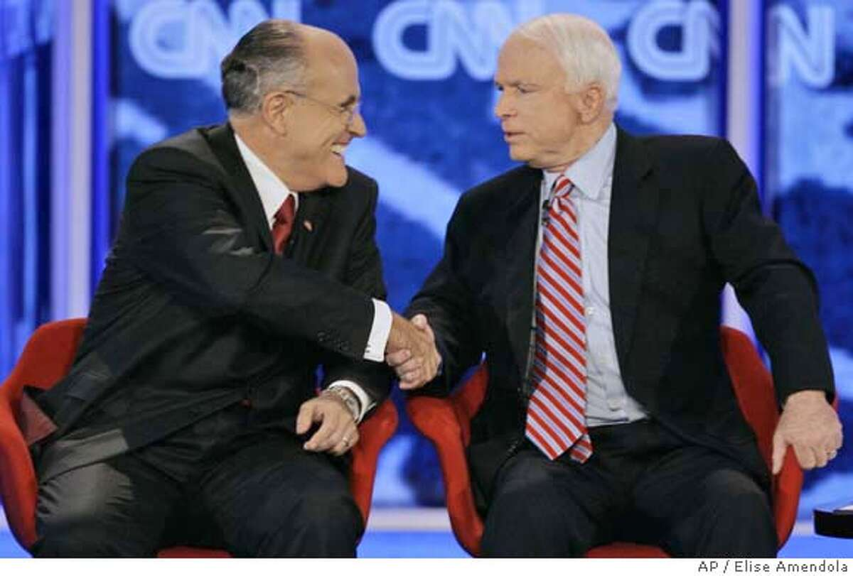 Republican presidential hopefuls former New York City Mayor Rudy Giuliani, left, and Sen. John McCain, R-Ariz. shake hands at the end of the Republican presidential primary debate hosted by Saint Anselm College in Manchester, N.H., Tuesday, June 5, 2007. (AP Photo/Elise Amendola)
