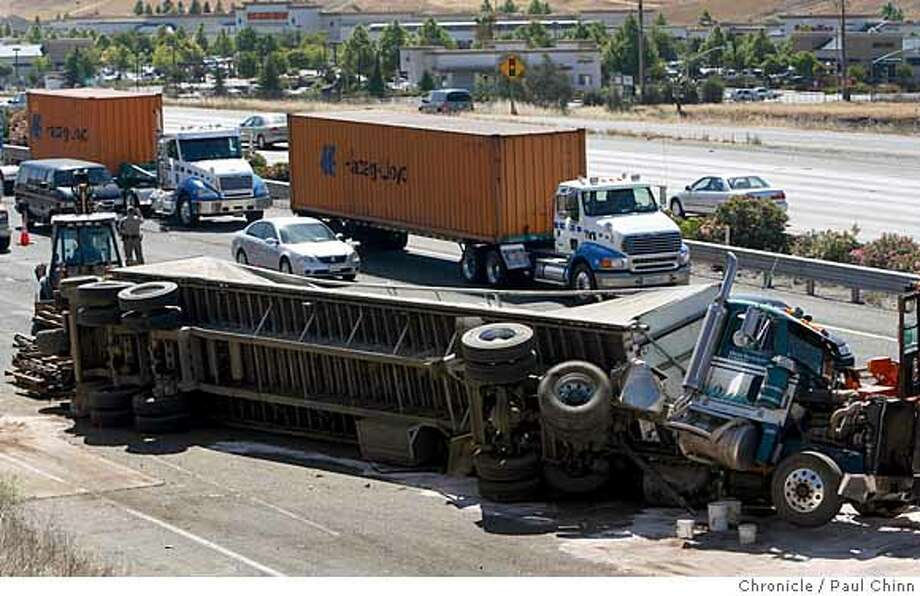 Traffic squeezes past the scene of a major accident between a big rig and a pickup truck that closed the two right lanes of Interstate 580 at North Livermore Avenue in Livermore, Calif. on June 7, 2007. Westbound traffic remained backed up as far as Grant Line Road east of the Altamont Pass for several hours after the accident which occurred around 6 a.m.  PAUL CHINN/The Chronicle Photo: PAUL CHINN