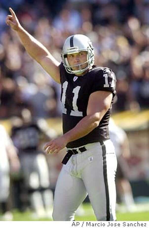 Oakland Raiders kicker Sebastian Janikowski celebrates after kicking a 40-yard field goal in the final seconds to win the game against the Cincinnati Bengals in Oakland, Calif., on Sunday, Sept. 14, 2003. Raiders won, 23-20. (AP Photo/Marcio Jose Sanchez) Photo: MARCIO JOSE SANCHEZ