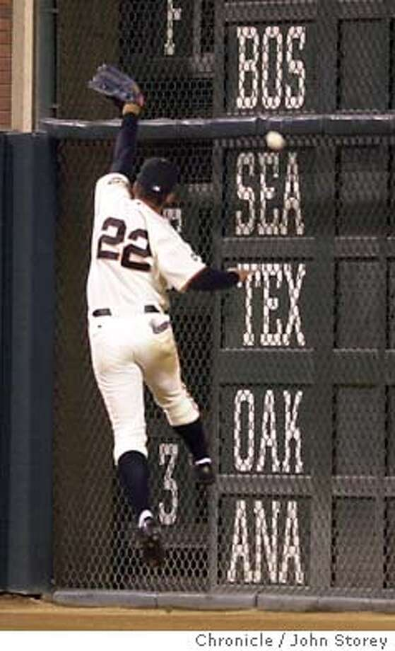 DSC_0132.JPG  The Giants vs. the San Diego Padres at Pac Bell Park. Jose Cruz Jr. of the Giants can't get a double by Phil Nevin of the Padres in the 4th inning. . 9/15/03 in San Francisco. JOHN STOREY / The Chronicle Photo: JOHN STOREY