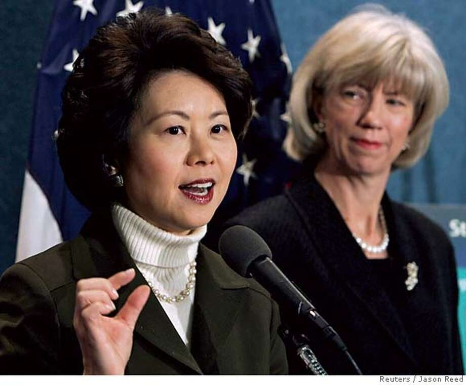 U.S. Secretary of Labor Elaine Chao (L) speaks alongside Interior Secretary Gale Norton during a news conference on oil drilling in Alaska, at the National Press Club in Washington, December 12, 2005. The Bush administration officials on Monday urged Congress to include opening of Alaska's Arctic National Wildlife Refuge to oil drilling in a broad budget-cutting bill that could see a vote this week. REUTERS/Jason Reed 0 Photo: JASON REED