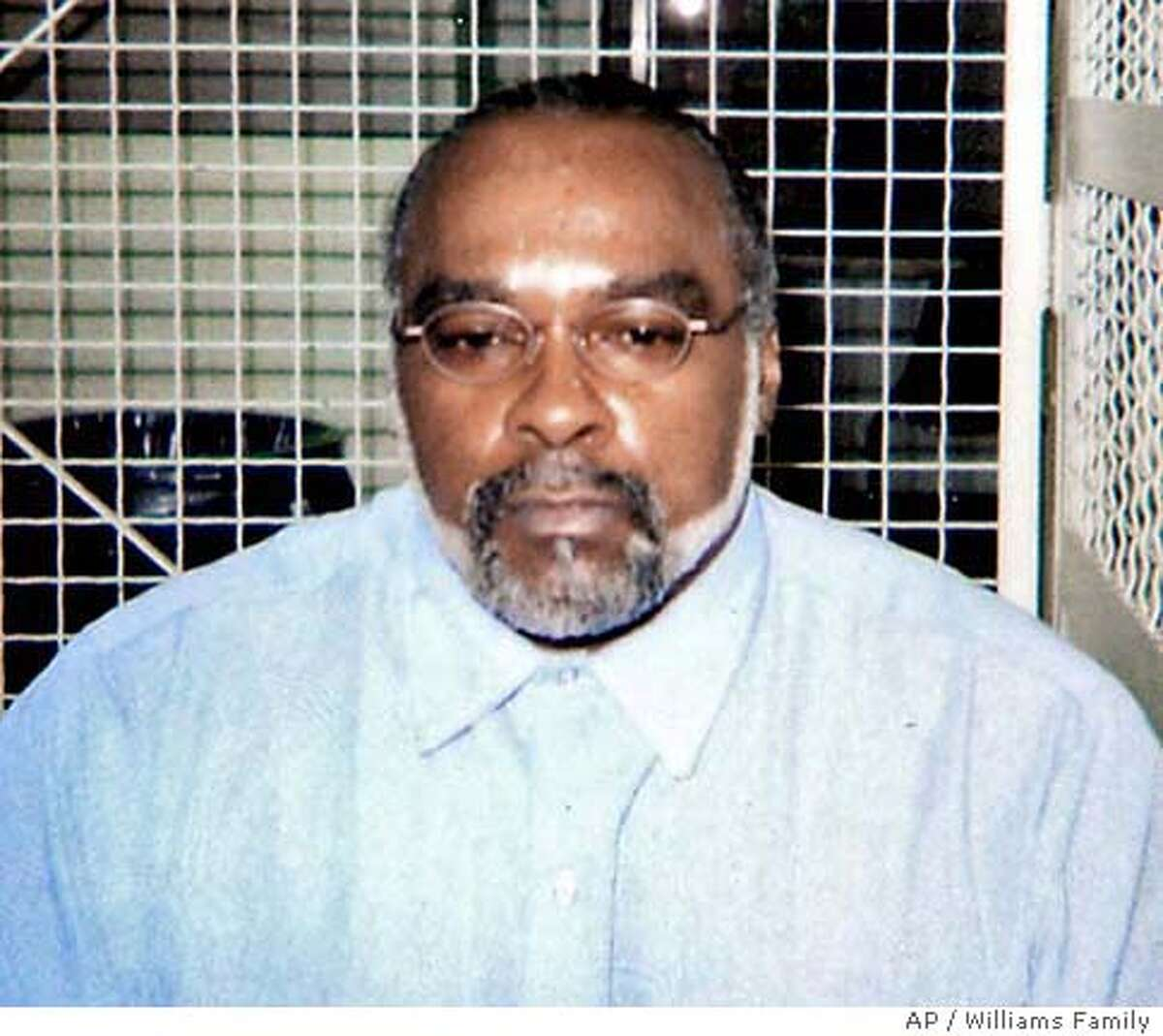 """** FILE ** In this undated photo provided by the family of Stanley Williams, Stanley """"Tookie"""" Williams poses for a photo in the visiting area of San Quentin State Prison in California. Prosecutors asked the California Supreme Court on Sunday, Dec. 11, 2005 to reject former gang leader and convicted killer Williams' request to block his execution, set for early Tuesday. (AP Photo/Courtesy of Williams Family, File) UNDATED HANDOUT"""