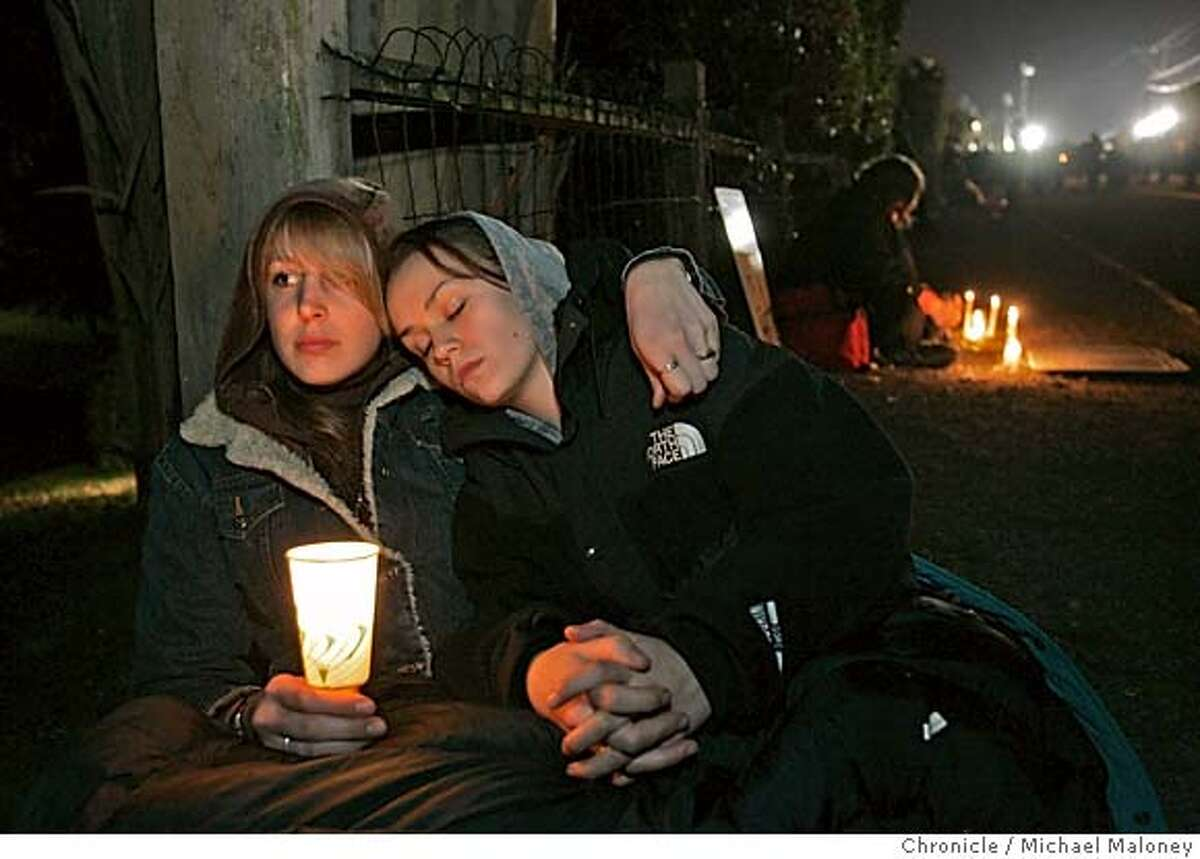 """Amanda Barovro of Argentina and Sylvia Calierno of Berkeley comfort each other after Williams was executed. The vigil outside the gates to San Quentin Prison where Stanley """"Tookie"""" Williams was executed shortly after midnight, Tuesday morning December 13, 2005. Pro and anti death penalty advocates were on hand to voice and demonstrate their views. Williams, once the leader of the Crypts gang was convicted and sentenced to death for 4 murders. The governor refused clemency for Williams Monday. Event in San Quentin, CA Photo by Michael Maloney / The Chronicle"""