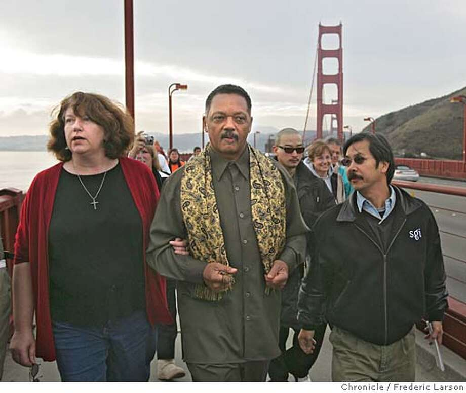 "WILLIAMS_296_fl.jpg The Williams case has attracted so much national attention the walk this time has brought out a lot of first timers. The Reverend Jesse Jackson joined the some two dozen marchers including Butch Wing (right) and Joan Juster (left) today as they made their way across the Golden Gate Bridge. ""We're making a moral appeal to Arnold Schwarzenegger to grant a reprieve or to grant clemency,"" he said. ""He has inherent value as a human being as created in the image of God but it's that specific value to society as a peacemaker that I think got me out here,"" said first time marcher Episcopal Rev. Kathy McAdams. The two dozen or so marchers, some holding signs like Barbara Baker that say 'Arnold have a heart' and 'Don't kill me' are taking their message to 12/12/05 San Francisco CA Frederic Larson San Francisco Chronicle Photo: Frederic Larson"