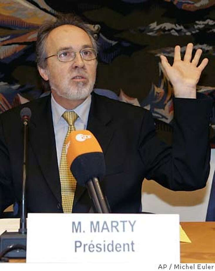 European investigator, Swiss Senator Dick Marty, gestures as he presents his report on secret CIA prisons in eastern Europe to the Council of Europe Committee in Paris Tuesday, Dec. 13, 2005.(AP Photo/Michel Euler) Photo: MICHEL EULER
