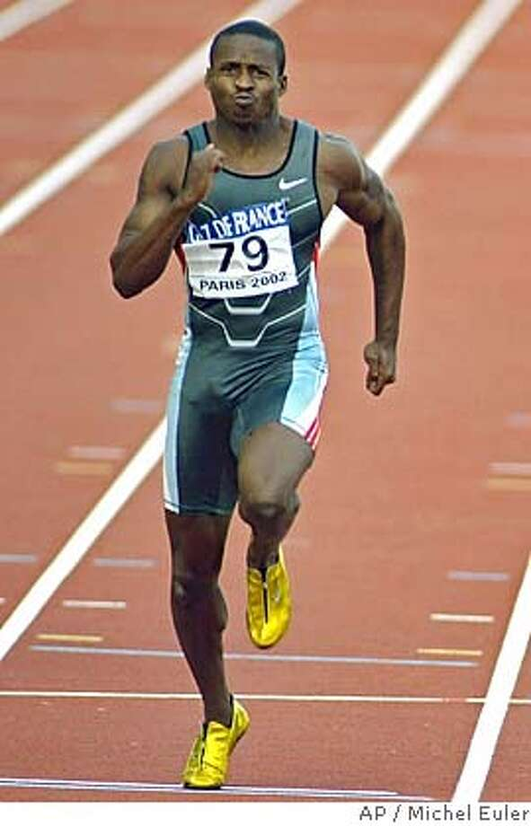 ** FILE ** American Tim Montgomery runs on his way to setting a new world record of 9.78 seconds in the men's 100m race, during the final of the IAAF Grand Prix track and field meeting at the Charlety stadium in Paris, Saturday, Sept. 14, 2002. Montgomery was suspended for two years for doping Tuesday Dec. 13, 2005, and the 100-meter world record he once held was wiped from the books. (AP Photo/Michel Euler) Photo: MICHEL EULER